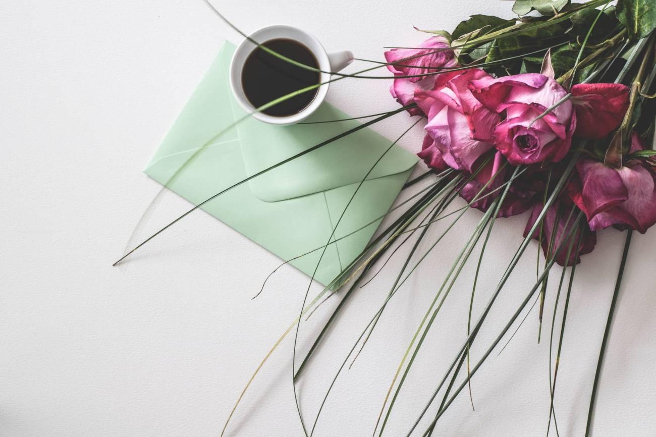 bouquet of pink flowers beside white ceramic mug