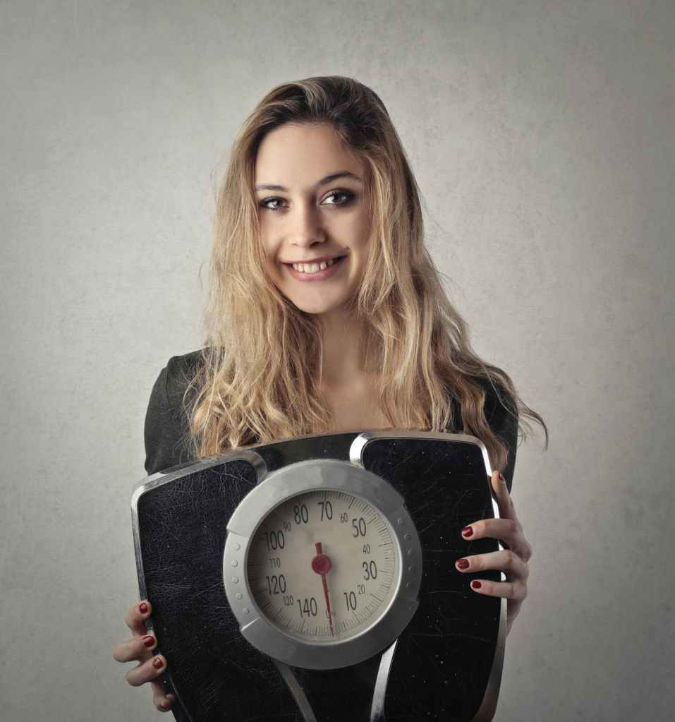 A girl with her weighing machine